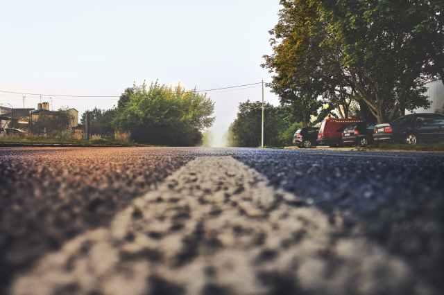 asphalt cars countryside daylight